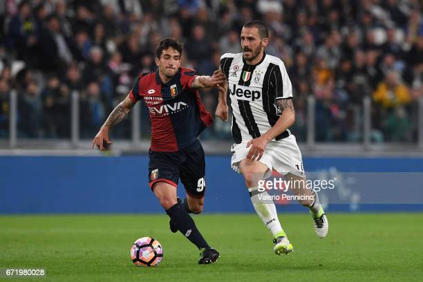 Leonardo Bonucci of Juventus FC is challenged by Danilo Cataldi of Genoa CFC during the Serie A match between Juventus FC and Genoa CFC at Juventus...