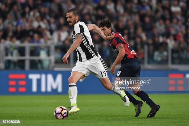 Leonardo Bonucci of Juventus FC is challenged by Danilo Cataldi of Genoa CFC during the Serie A match between Juventus FC and Genoa CFC at Juventus...
