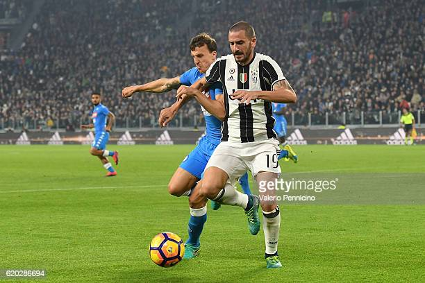 Leonardo Bonucci of Juventus FC is challenged by Vlad Iulian Chiriches of SSC Napoli during the Serie A match between Juventus FC and SSC Napoli at...