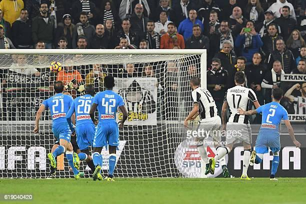 Leonardo Bonucci of Juventus FC scores the opening goal during the Serie A match between Juventus FC and SSC Napoli at Juventus Stadium on October 29...