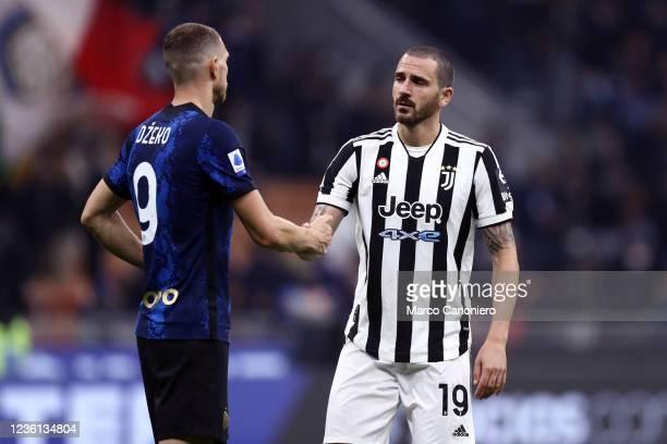 Leonardo Bonucci of Juventus Fc shakes hands with Edin Dzeko of Fc Internazionale at the end of the Serie A match between Fc Internazionale and...