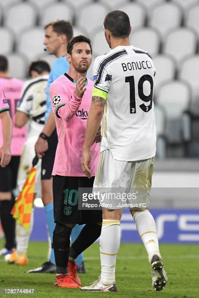 Leonardo Bonucci of Juventus greets Lionel Messi of FC Barcelona after the UEFA Champions League Group G stage match between Juventus and FC...
