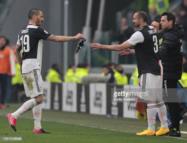 Leonardo Bonucci of Juventus is replaced by his team-mate Giorgio Chiellini during the Serie A match between Juventus and Brescia Calcio at Allianz...