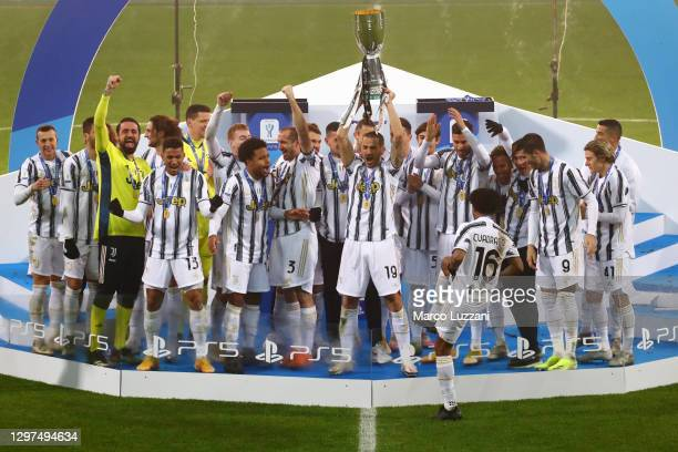 Leonardo Bonucci of Juventus lifts the PS5 Supercup following their side's victory in the Italian PS5 Supercup match between Juventus and SSC Napoli...