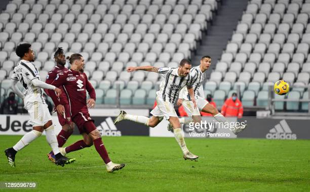 Leonardo Bonucci of Juventus scores his sides second goal during the Serie A match between Juventus and Torino FC at Allianz Stadium on December 05,...