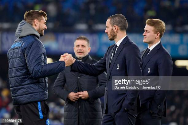 Leonardo Bonucci of Juventus shakes hand to Fernando Torres Llorente of SSC Napoli before the Serie A match between SSC Napoli and Juventus at Stadio...