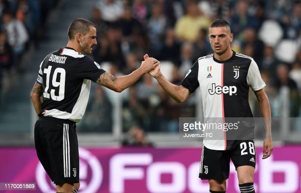 Leonardo Bonucci of Juventus shakes the hand to his teammate Merih Demiral during the Serie A match between Juventus and Hellas Verona at Allianz...