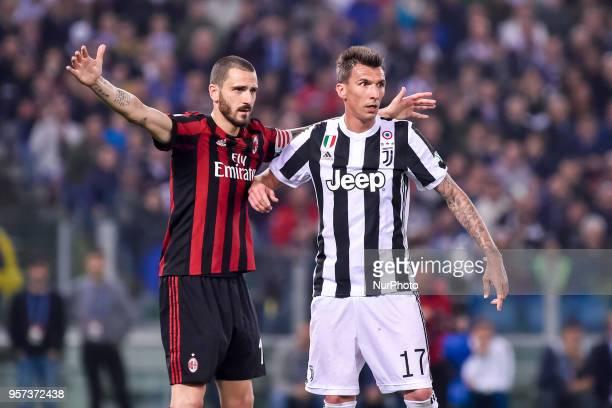 Leonardo Bonucci of Milan fights with Mario Mandzukic of Juventus during the TIM Cup Coppa Italia final match between Juventus and AC Milan at Stadio...