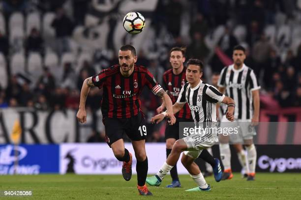 Leonardo Bonucci of Milan holds off the challenge from Paulo Dybala of Juventus during the serie A match between Juventus and AC Milan at Allianz...