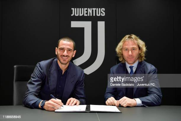 Leonardo Bonucci poses with Pavel Nedved as he extends his contract with Juventus on November 19 2019 in Turin Italy