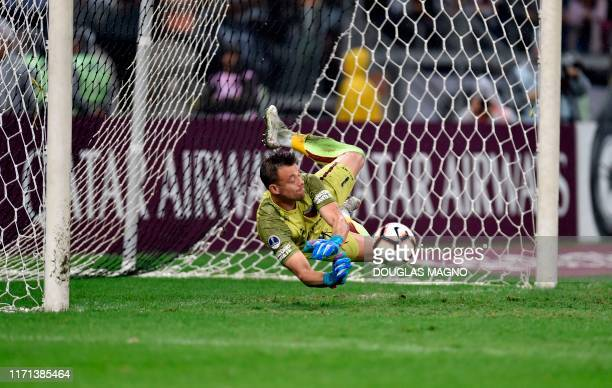Leonardo Burian goalkeeper of Argentina's Colon catches the ball during a penalty shootout after a 2019 Copa Sudamericana football match against...