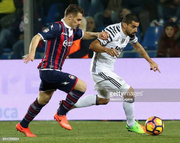 Leonardo Capezzi of Crotone competes for the ball with Tomas Rincon of Juvents during the Serie A match between FC Crotone and Juventus FC at Stadio...