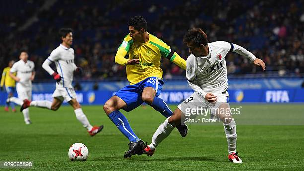 Leonardo Castro of Mamelodi Sundowns is closed down by Atsutaka Nakamura of Kashima Antlers during the FIFA Club World Cup second round match between...