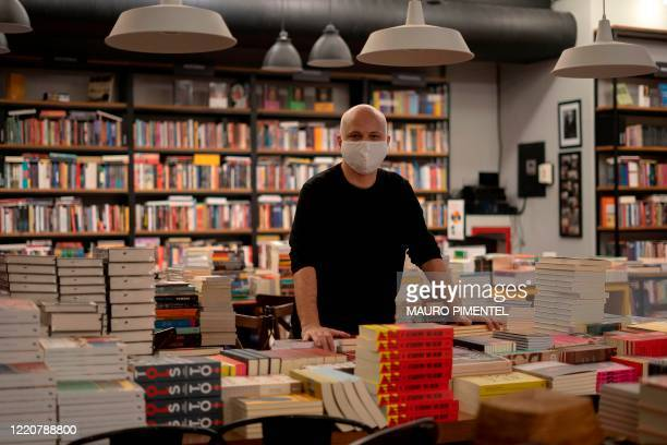 Leonardo Da Vinci bookstore owner, Brazilian bookseller Daniel Louzada poses for a photo at his store, which remains closed to follow social distance...