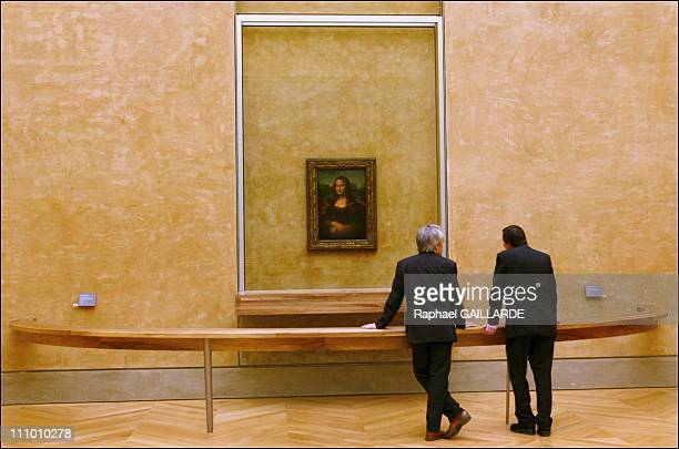 Leonardo da Vinci's masterpiece Mona Lisa in her new setting in the refurbished Salle des Etats where the public was able to rediscover her in Paris...