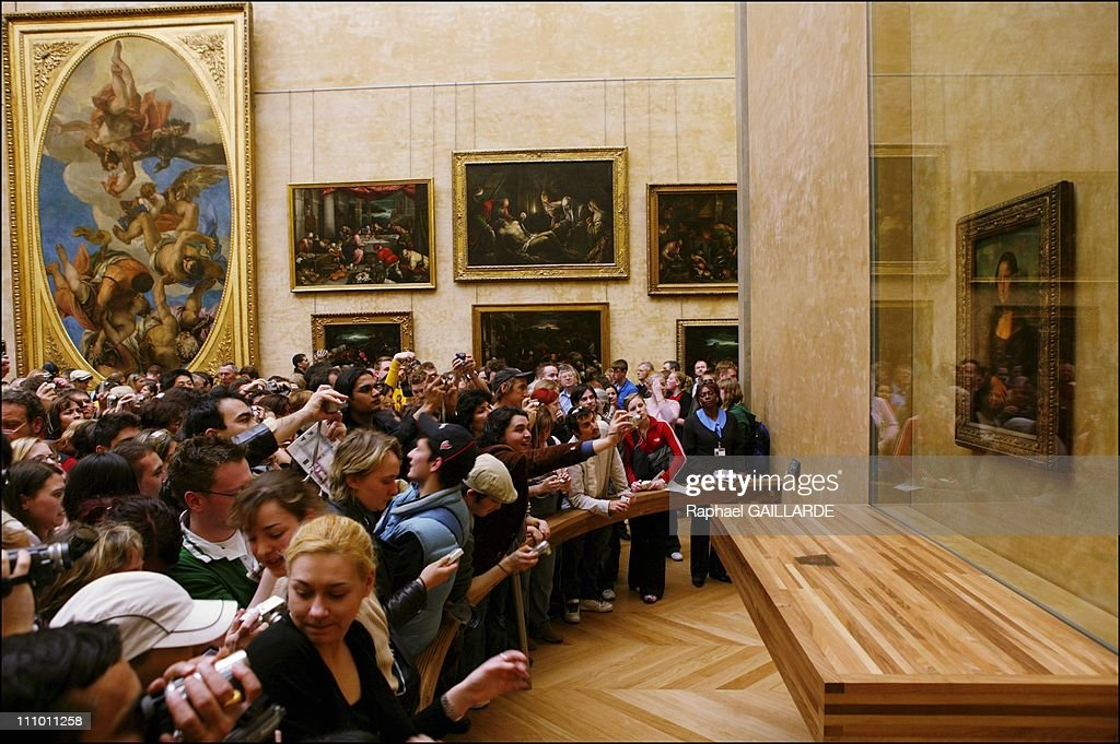 Leonardo da Vinci's masterpiece, Mona Lisa in her new setting in the refurbished Salle des Etats where the public was able to rediscover her in Paris, France on April 06th, 2005.