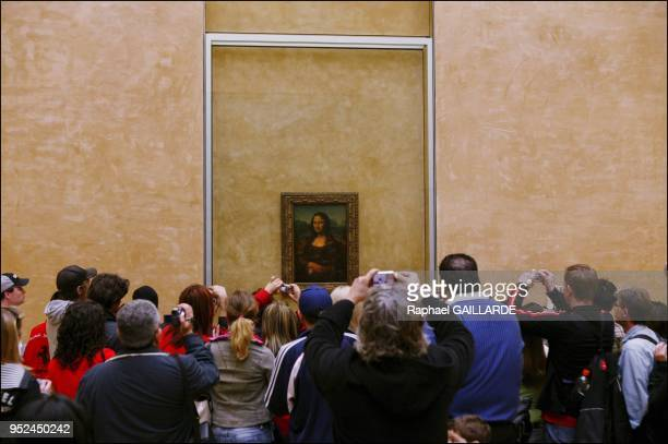Leonardo da Vinci's masterpiece Mona Lisa in her new setting in the refurbished Salle des Etats where the public was able to rediscover her April 6