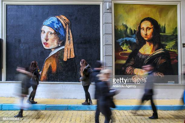 Leonardo da Vinci's ''Mona Lisa'' and Johannes Vermeer's ''Girl With A Pearl Earring''made from plastic cover by municipal personnel as part of the...