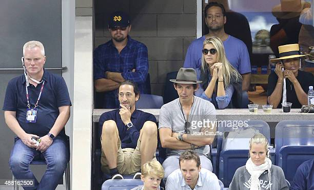 Leonardo DiCaprio and girlfriend Kelly Rohrbach below them Adrien Brody and Lukas Haas attend the Men's Final on day fourteen of the 2015 US Open at...