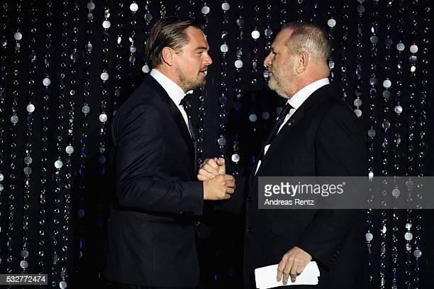 Leonardo DiCaprio and Harry Weinstein appear on stage at the amfAR's 23rd Cinema Against AIDS Gala at Hotel du CapEdenRoc on May 19 2016 in Cap...