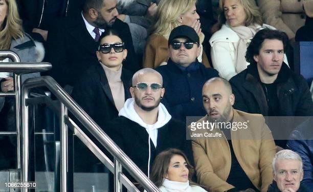 Leonardo DiCaprio and his girlfriend Camila Morrone below DJ Snake attend the Group C match of the UEFA Champions League between Paris SaintGermain...