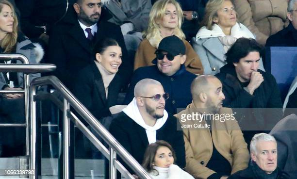 Leonardo DiCaprio and his girlfriend Camila Morrone, below DJ Snake attend the UEFA Champions League Group C match between Paris Saint-Germain and...