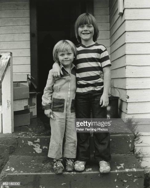 Leonardo DiCaprio and his stepbrother Adam Ferrar pose for a portrait outside their home in July 1978 in Hollywood California