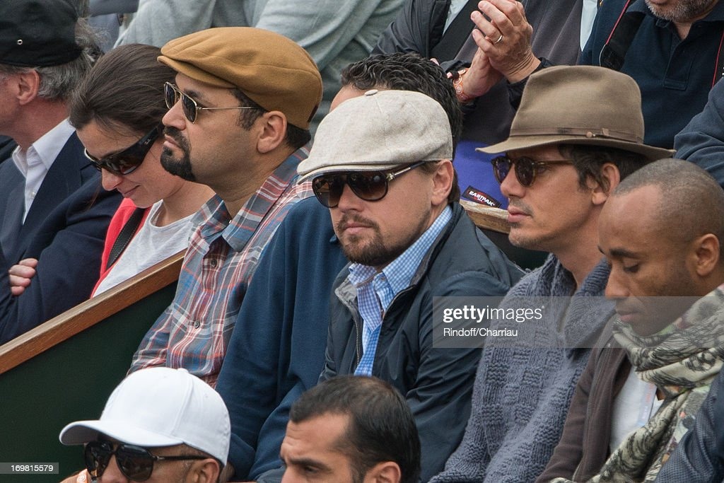 Leonardo DiCaprio and Lukas Haas sighting at the French open 2013 at Roland Garros on June 2, 2013 in Paris, France.