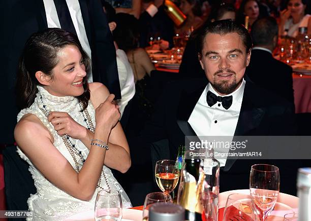 Leonardo DiCaprio and Marion Cotillard attend amfAR's 21st Cinema Against AIDS Gala Presented By WORLDVIEW, BOLD FILMS, And BVLGARI at Hotel du...