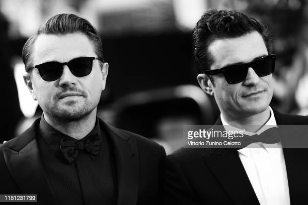 Leonardo DiCaprio and Orlando Bloom attend the screening of The Traitor during the 72nd annual Cannes Film Festival on May 23 2019 in Cannes France