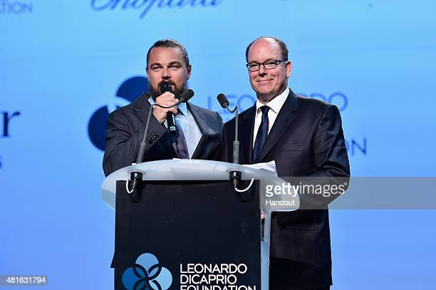 Leonardo DiCaprio and Prince Albert II of Monaco speak on stage during Dinner and Auction during The Leonardo DiCaprio Foundation 2nd Annual...