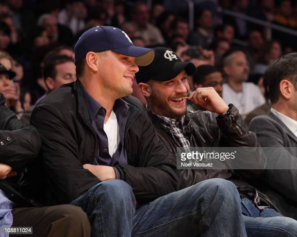 Leonardo DiCaprio and Tom Hardy attend a game between the San Antonio Spurs and the Los Angeles Lakers at Staples Center on February 3 2011 in Los...