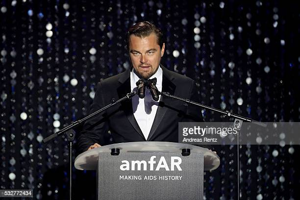 Leonardo DiCaprio appears on stage at the amfAR's 23rd Cinema Against AIDS Gala at Hotel du Cap-Eden-Roc on May 19, 2016 in Cap d'Antibes, France.