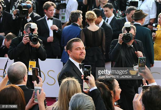 Leonardo DiCaprio arrives on the red carpet for the 88th Oscars on February 28 2016 in Hollywood California LACROIX