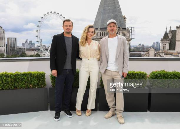 Leonardo DiCaprio Margot Robbie and Brad Pitt attend the Once Upon A Time…In Hollywood Photocall in London at The Corinthia Hotel on July 31 2019 in...