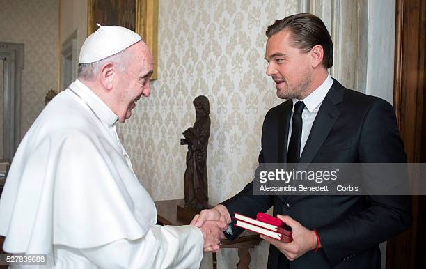 Leonardo DiCaprio met with Pope Francis at the Vatican on January 28 2016 and was presented with leather-bound copies of the Pope's two...