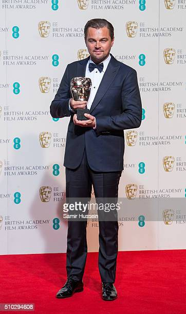 Leonardo DiCaprio poses in the winners room at the EE British Academy Film Awards at The Royal Opera House on February 14 2016 in London England