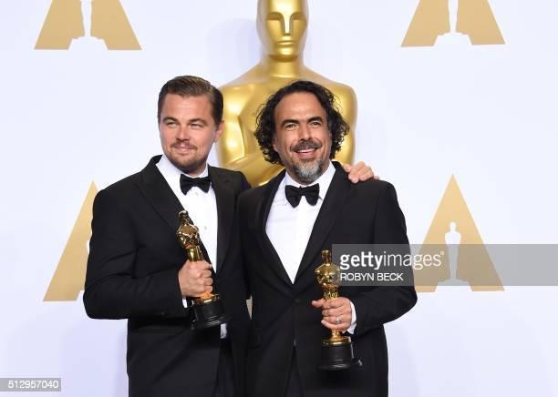 TOPSHOT Leonardo DiCaprio poses with the Oscar for Best Actor and Alejandro G Iñárritu poses with the Oscar for Best Director in the press room...
