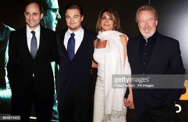 Leonardo DiCaprio, second left, with director Ridley Scott, right and his partner Giannina Facio and British actor, Mark Strong at the UK film...