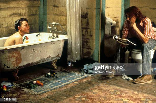 Leonardo DiCaprio sits in a bathtub while Johnny Depp watches in a scene from the film 'What's Eating Gilbert Grape' 1993