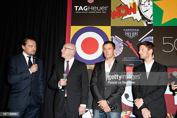 Leonardo DiCaprio TAG Heuer's CEO Stephane Linder Sebastien Ogier and Romain Grosjean speak on stage during the Opening of the TAG Heuer New Boutique...