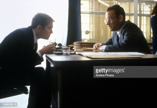 Leonardo DiCaprio talking to Tom Hanks in a scene from the film 'Catch Me If You Can' 2002 where they are playing Frank Abagnale Jr and FBI agent...