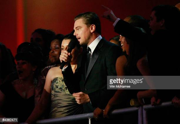 Leonardo DiCaprio talks with the the crowd during the Neighborhood Inaugural Ball on January 20 2009 in Washington DC President Barack Obama is...