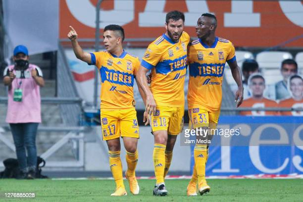 Leonardo Fernandez of Tigres celebrates with teammates after scoring the first goal of his team during the 12th round match between Monterrey v...