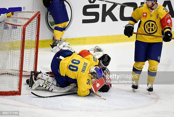 Leonardo Genoni of HC Davos Robin Figren of Frolunda Gothenburg in action during the Champions Hockey League semi final between Frolunda Gothenburg...