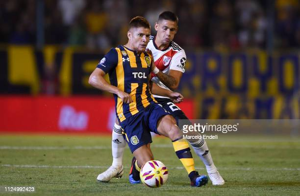 Leonardo Gil of Rosario Central fights for the ball with Lucas Martinez Quarta of River Plate during a match between Rosario Central and River Plate...