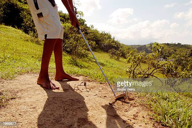 Leonardo Gomes Marques plays golf May 14 2003 at Japeri Municipal Public Golf Course in Rio de Janeiro suburb of Japeri The golf course was a cow...