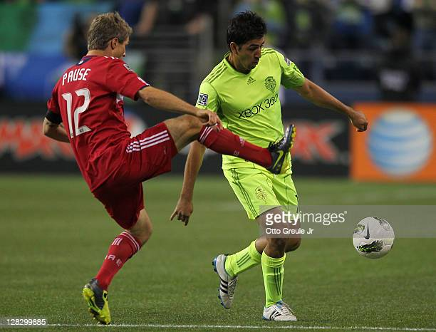 Leonardo Gonzalez of the Seattle Sounders FC dribbles Logan Pause of the Chicago Fire during the 2011 Lamar Hunt US Open Cup Final at CenturyLink...