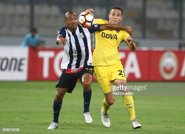 Leonardo Jara Boca Juniors struggles for the ball with Luis Ramirez of Alianza Lima during a groups stage match between Alianza Lima and Boca Juniors...