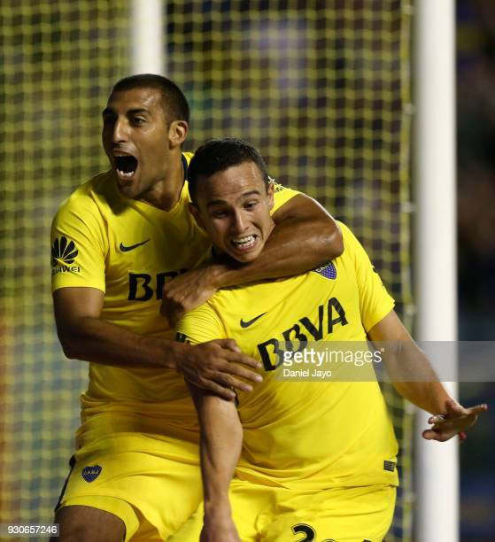 Leonardo Jara of Boca Juniors celebrates with teammate Ramon Abila of Boca Juniors after scoring during a match between Boca Juniors and Tigre as...